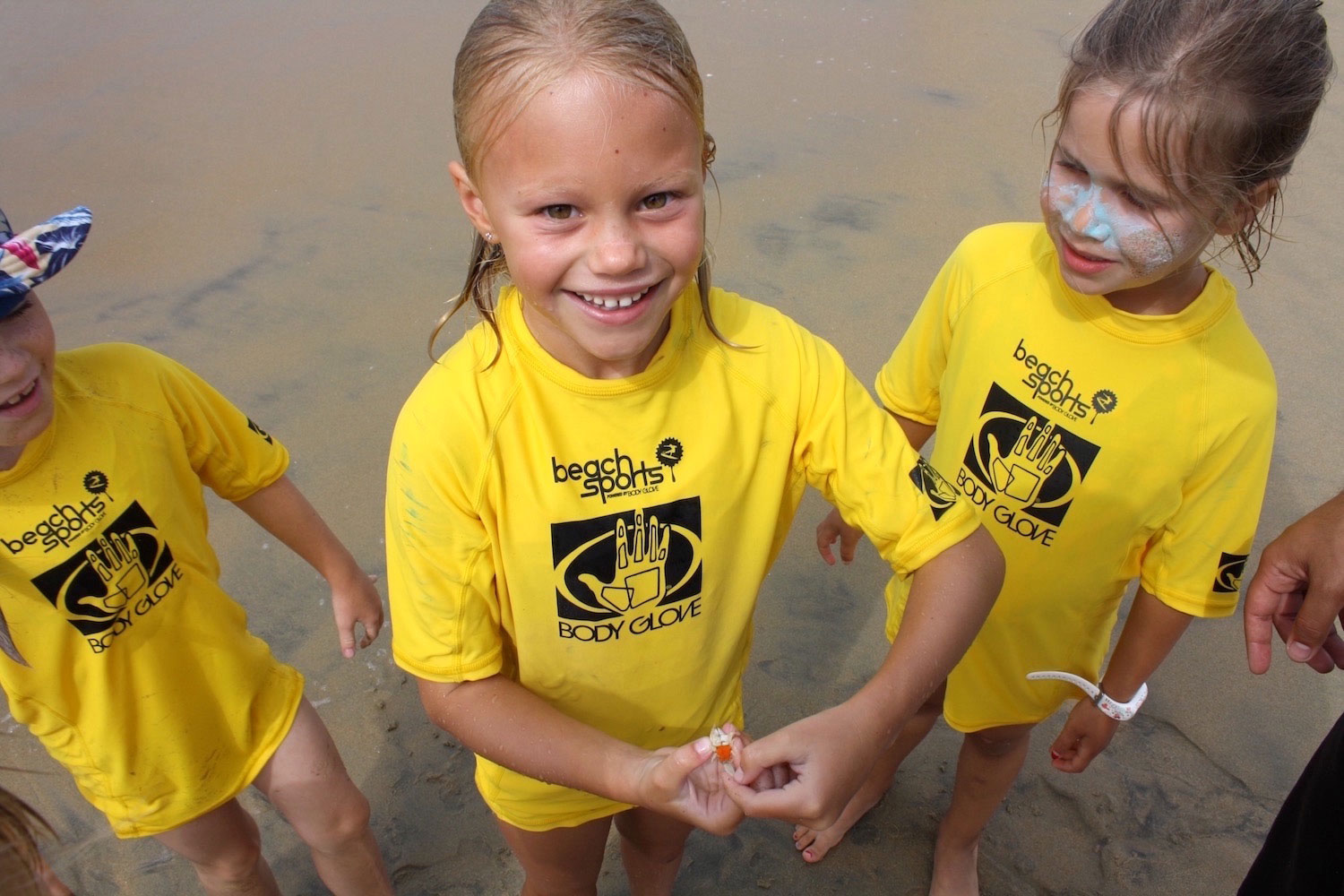 Beach Sports holding sand crabs 1