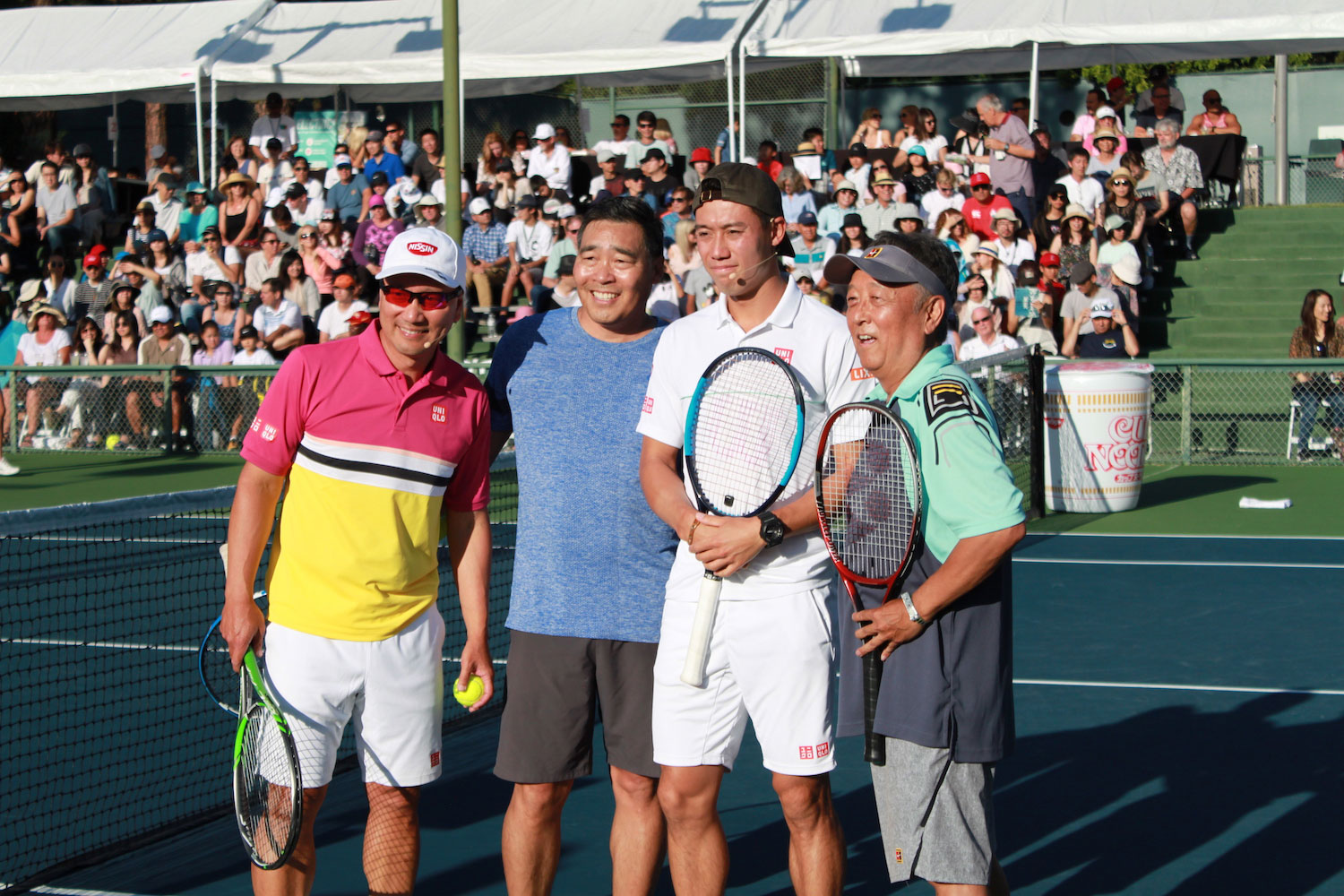 Michael Chang foursome on court